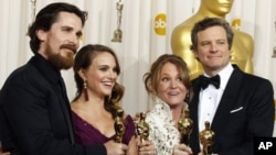 Academy Award winners for best supporting actor Christian Bale, best actress Natalie Portman, best supporting actress Melissa Leo and best actor Colin Firth (L-R) pose backstage at the 83rd Academy Awards in Hollywood, California on Feb. 27, 2011.