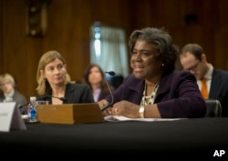 FILE - Then-U.S. Assistant Secretary of State for African Affairs Linda Thomas-Greenfield, right, testifies on Capitol Hill, Jan. 9, 2014.