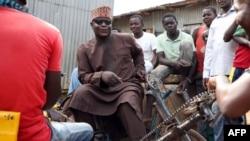 Portrait d'un chanteur nigérian aveugle