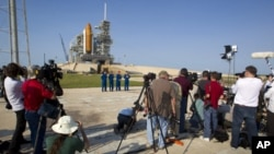 Space shuttle Atlantis STS-135 crew attend a news conference at launch pad 39A at the Kennedy Space Center in Cape Canaveral (file photo)