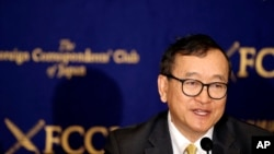 Cambodia's self-exiled opposition leader Sam Rainsy speaks during a press conference in Tokyo, Friday, April 13, 2018. Rainsy urged Japan, his nation's biggest donor, to use its leverage and convince the autocratic government to make sure that the July election is democratic. (AP Photo/Koji Sasahara)