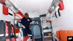 A Paramedic from the Kwazulu-Natal Emergencies Medical Rescue Services (EMR) inspects one of the 150 new Ambulances stationed at Durban's Wentworth Hospital, South Africa, 28 Feb 2010