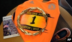 A gold laurel wreath, which is awarded to the winner of the Boston Marathon, is displayed at the Boston Athletic Association in Boston, April 1, 2015. The wreath, and other historic items from the race, will be on display when RunBase opens.
