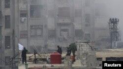 Thành viên của Quân đội Giải phóng Syria tại một khu vực trong thủ đô Damascus, ngày 6/2/2013.