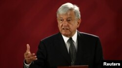 FILE - Mexican President Andres Manuel Lopez Obrador holds a news conference at the National Palace in Mexico City, Dec. 3, 2018.