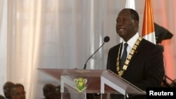 Ivory Coast President Alassane Ouattara speaks during his inauguration ceremony at the Presidential Palace in Abidjan, Nov. 3, 2015. Ouattara reappointed Daniel Kablan Duncan as prime minister and called for greater unity within the government, Jan. 06, 2016.