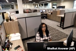 Shobha Surya, associate manager for projects and sales operations of Ajinomoto, a global food and pharmaceutical company, works in a shared office space in Itasca, Ill., Monday, June 7, 2021.