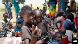 Une famille installée dans la région d'Aweil, au Soudan du Sud, le 16 septembre 2016.