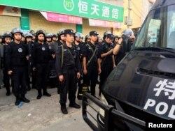 Policemen patrol at Wukan village in China's Guangdong province, June 20, 2016.