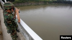A South Korean army soldier standing on a bridge searches for missing people in the Imjin River near the demilitarized zone separating the two Koreas.