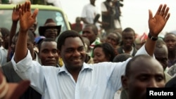 Hakainde Hichilema, United Democratic Alliance (UDA) leader and presidential candidate for Zambia's upcoming elections, greets his supporters at Zingalume compound in Lusaka.
