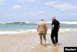 FILE - Israel's Prime Minister Benjamin Netanyahu (R) walks with India's Prime Minister Narendra Modi as they visit Olga Beach and a water desalination unit operated by G.A.L. Water Technologies, near Hadera, Israel, July 6, 2017.