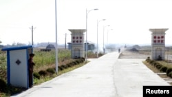 FILE - A North Korean soldier looks out from a sentry as he stands guard at an entrance to the Hwanggumpyong Economic Zone near the North Korean town of Sinuiju, opposite China's border city of Dandong.