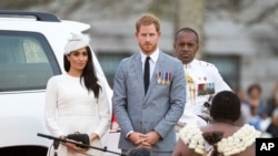 FILE - Prince Harry, Duke of Sussex and Meghan, Duchess of Sussex attend an official welcome ceremony in Albert Park on October 23, 2018 in Suva, Fiji