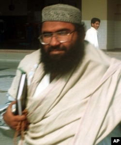 FILE - Muslim cleric Masood Azhar arrives at Karachi airport, Jan. 22, 2000.