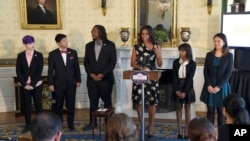 First lady Michelle Obama speaks in the Blue Room of the White House in Washington, Oct. 8, 2015, during an event to honor the 2015 class of the National Student Poets Program (NSPP), the nation's highest honor for youth poets.
