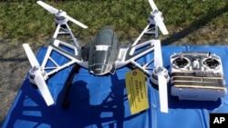 FILE - An Aug. 2015 photo of Yuneec Typhoon drone and controller in Jessup, Maryland, where State Police and prison officials say two men planned to use the drone to smuggle drugs, tobacco and pornography videos into the maximum-security Western Correctional Institution near Cumberland, Md. Illinois has yet to see a case where drones have been used to illegally smuggle items into correctional facilities, according to state officials.