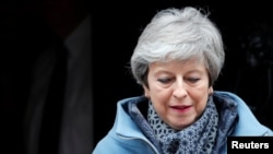 Britain's Prime Minister Theresa May leaves 10 Downing Street as she faces votes on Brexit options, in London, March 27, 2019.