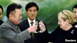 FILE - Former North Korean Leader Kim Jong Il toasts former U.S. Secretary of State Madeleine Albright at a 2000 dinner in Pyongyang. The U.S.-North Korea nuclear agreement struck during the Bill Clinton administration fell apart after Clinton left office.