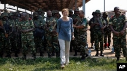 US Ambassador to the United Nations Samantha Power meets peacekeepers from Burundi at the airport in Bangui, Central African Republic, Dec. 19, 2013. Peacekeepers from Burundi are accused of sexual abuse while in the Central African Republic.