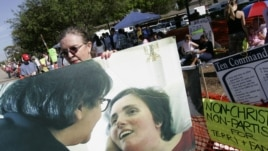 A supporter holds a large photo of Terri Schiavo in Pinellas Park, Fla. in 2005