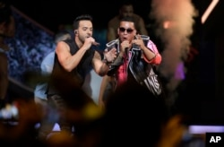 Singers Luis Fonsi, left and Daddy Yankee perform during the Latin Billboard Awards, April 27, 2017, in Coral Gables, Florida.