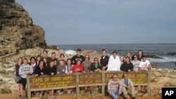 Dr. William Finlay (seated right) on a hike with a study-abroad group in South Africa.