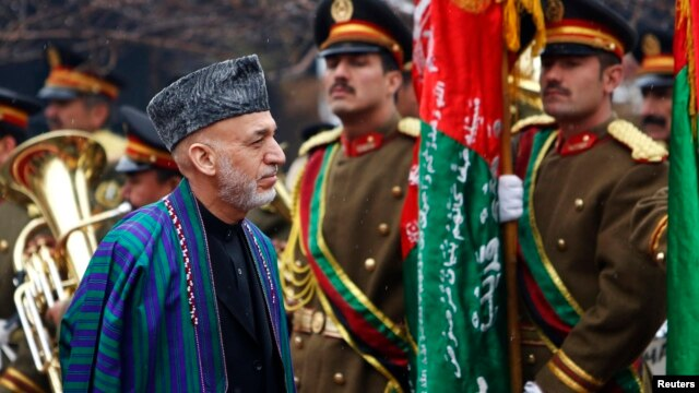 Afghanistan's President Hamid Karzai arrives at the opening ceremony of the fourth year of the Afghanistan parliament in Kabul, March 15, 2014.