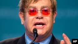 Sir Elton John speaks at the XIX International Aids Conference, July 23, 2012, in Washington.