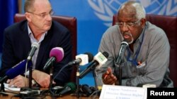 David Shearer, left, head of the U.N. Mission in South Sudan (UNMISS), and UNMISS Human Rights Director Eugene Nindorera address a news conference in Juba, South Sudan, Feb. 22, 2018.