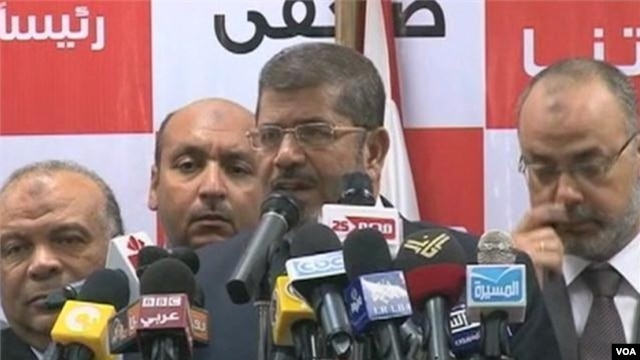 Muslim Brotherhood's Morsi Claims Win, Egypt's Military Claims Powers