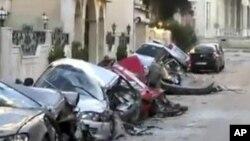 在叙利亚的霍姆斯,被炮火击毁的汽车历历在目