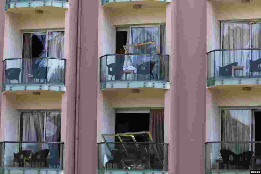 Broken windows are seen in a hotel following a blast in a military ammunition depot near the town of Kyrenia in northern Cyprus.
