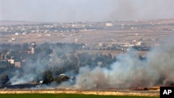 Дым пожарищ после боя за селение Кунейтра на Голанах. Сирия. 6 июня 2013 г.