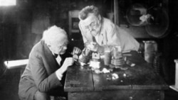 Inventors Thomas Edison, left, and Charles Steinmetz in a laboratory