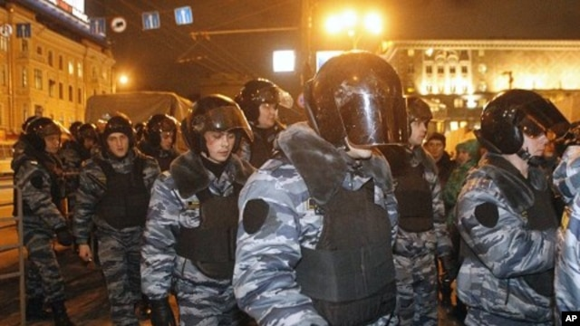 Police arrive at Triumphal Square during protests against alleged vote rigging in Russia's parliamentary elections in Moscow, Russia, December 6, 2011.