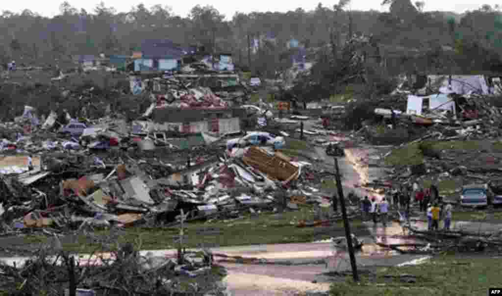 Residents survey the destruction after a tornado hit Pratt City, Ala. just north of downtown Birmingham, Ala. on Wednesday, April 27, 2011. A wave of severe storms laced with tornadoes strafed the South on Wednesday, killing at least 16 people around the