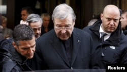 FILE - Australian Cardinal George Pell leaves at the end of a meeting with the victims of sex abuse, at the Quirinale hotel in Rome, Italy, March 3, 2016. (REUTERS/Alessandro Bianchi)