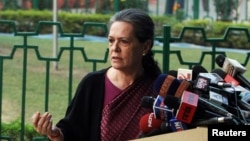 FILE - Chief of India's ruling Congress party Sonia Gandhi (R) speaks during a news conference in New Delhi.