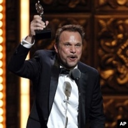 """Norbert Leo Butz accepts the Tony Award for Best Performance by an Actor in a Leading Role in a Musical for """"Catch Me If You Can"""" during the 65th annual Tony Awards, Sunday, June 12, 2011 in New York."""
