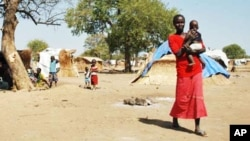 Darfur's displaced set up huts near and old airstrip in the village of Jaac in southern Sudan.