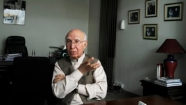 Sartaj Aziz, currently Pakistan's foreign policy chief, gestures during an interview at his office in Lahore in this May 24, 2013, file photo.