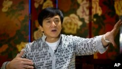 FILE - Action star Jackie Chan speaks during an interview in Beijing, Aug. 3, 2015.