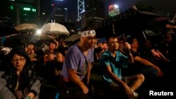 Pro-democracy protesters attend a campaign to kick off the Occupy Central civil disobedience event in Hong Kong August 31, 2014.