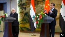 Pekin'de bulunan Suriye Dışişleri Bakanı Velid Muallim, Çinli mevkidaşı Wang Yi ile ortak basın toplantısı düzenlerken