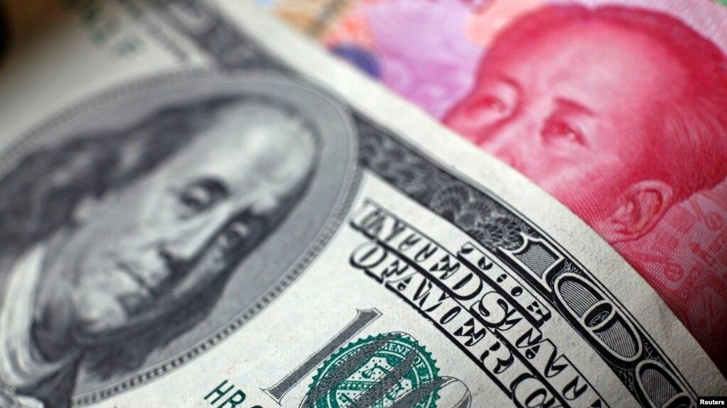 人民币贬值成双刃剑 中国称将保持汇率基本稳定
