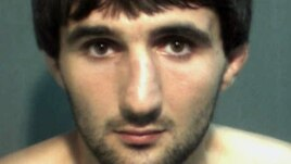 In this May 4, 2013 police mug provided by the Orange County Corrections Department in Orlando, Fla., shows Ibragim Todashev after his arrest for aggravated battery in Orlando.