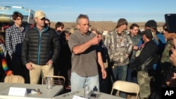 Robert F. Kennedy Jr., center, an environmental attorney and president of the New York-based Waterkeeper Alliance, speaks with opponents of the Dakota Access oil pipeline at the main protest camp, Nov. 15, 2016, near Cannon Ball, N.D.