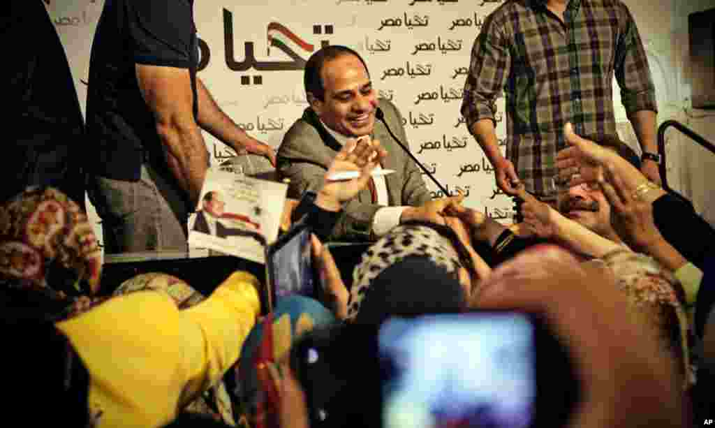 This photo released by the presidential campaign of Abdel-Fattah el-Sissi shows the candidate greeting supporters at a gathering of about 600 women, in Cairo, May 5, 2014.