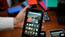 FILE - An Amazon Fire tablet is displayed in San Francisco, Sept. 16, 2015.